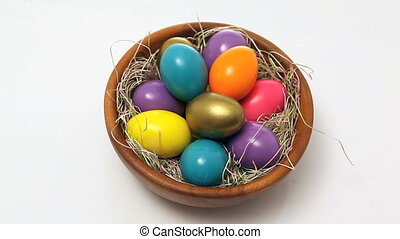 easter eggs in basket isolated white background