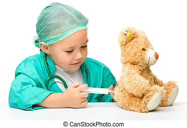 Little girl is playing doctor with syringe