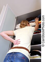 Housewife with wardrobe from beyond - Housewife in front of...