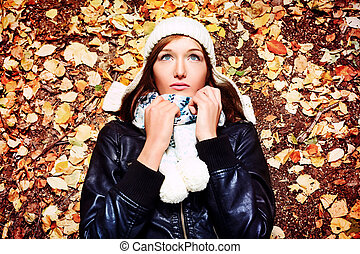 leafage - Beautiful young woman at the autumn park.