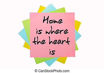 "text ""  Home is where the heart is "" written by hand font on bunch of colored sticky notes"