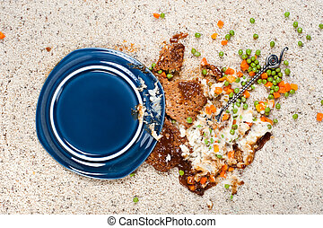 Spilled plate of food on carpet - A plate of meatloaf with...