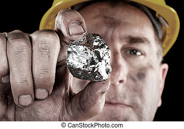 Silver miner with nugget - A silver miner shows off his...