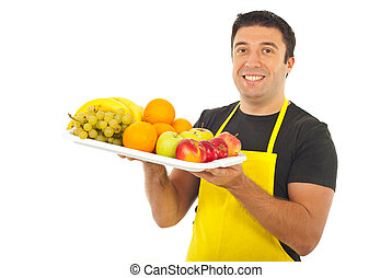 Happy market worker holding fruits - Happy market worker...