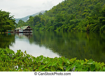 houseboat lake and forest. view of Thailand