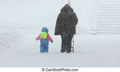 mother and child walking at winter
