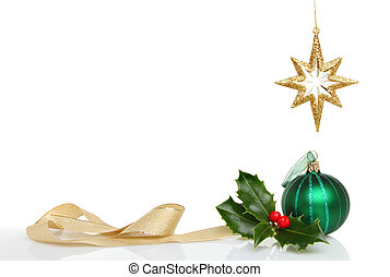 Christmas decorations with copy space, green bauble, gold...