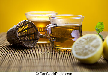 Glass cup of tea - Glass teapot and cup with tea, lemon