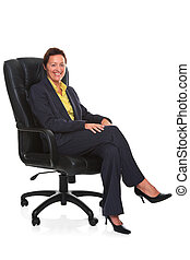 Mature businesswoman sat in leather chair isolated