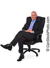 Businessman sat in a leather chair.