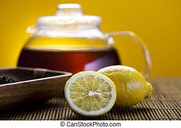 Lemon tea - Glass teapot and cup with tea, lemon