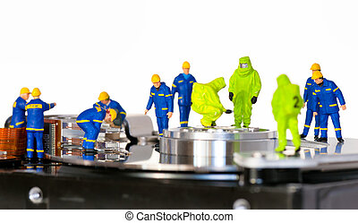 Team of technicians repair hard disk. Hard Drive repair...