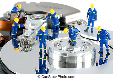 Hard Drive repair concept - Group of workers repairing HDD....