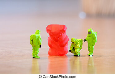 Group of people in protective suit inspecting a jelly bear....