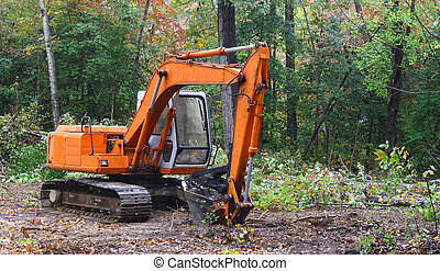 A construction Excavator used forexcavating of trees debris...