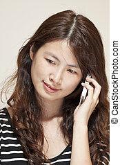 Asian woman using phone