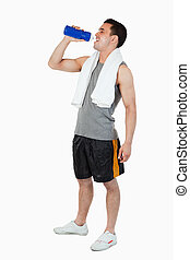 Young male drinking after workout