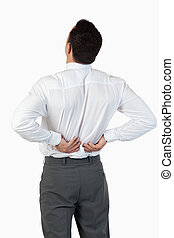 Portrait of the painful back of a young businessman against...