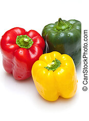 Bell peppers green, yellow and red isolated on white...