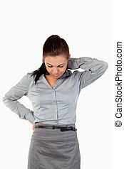 Portrait of a sad businesswoman having back pain