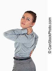 Portrait of a businesswoman having back pain