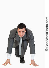 Portrait of a businessman in the starting blocs