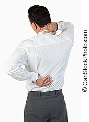 Portrait of the painful back of a businessman against a...