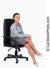 Portrait of a businesswoman sitting on an armchair