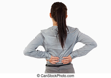 Painful back of a businesswoman against a white background