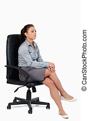 Portrait of a serious businesswoman sitting on an armchair