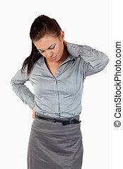 Portrait of a cute businesswoman having back pain
