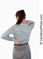 Portrait of the painful back of a businesswoman