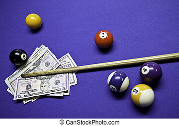 Cash on pool table - A selection of pool balls with cash.