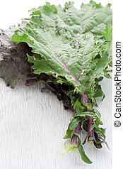Red Kale - Red kale on white wooden board