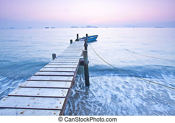 Jetty sunset along coast with waves movement