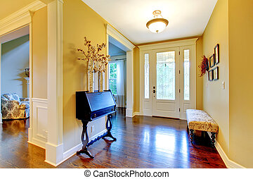 Luxury home entrance and hallway in golden yellow. - Hallway...