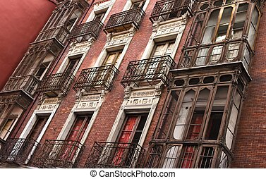 Ruined Facade - Old red ruined facade with balconies in...