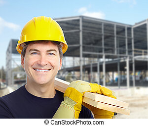 Worker. - Industrial worker with yellow helmet at the...