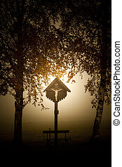 cross in bavaria - An image of a beautiful cross with fog in...