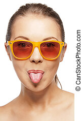 teenage girl in shades sticking out her tongue - picture of...
