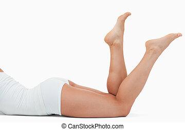 Feminine body lying on the floor