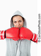 Young female boxer wearing hoodie sweater