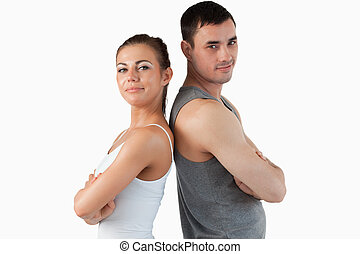 Fit couple posing against a white background