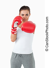Young female boxer striking with her left