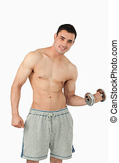 Young man doing weight lifting against a white background