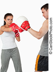 Young female boxer practicing