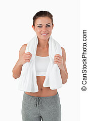 Sportswoman with towel around her neck