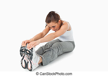 Young female doing stretches before workout