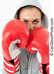 Young female boxer with hoodie on