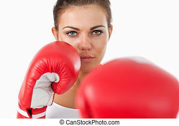 Female boxer attacking with her left